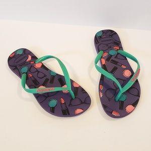 Havaianas   purple and green flip flops